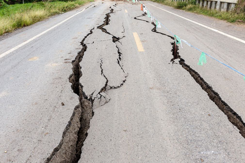 Earthquake damage in roadway